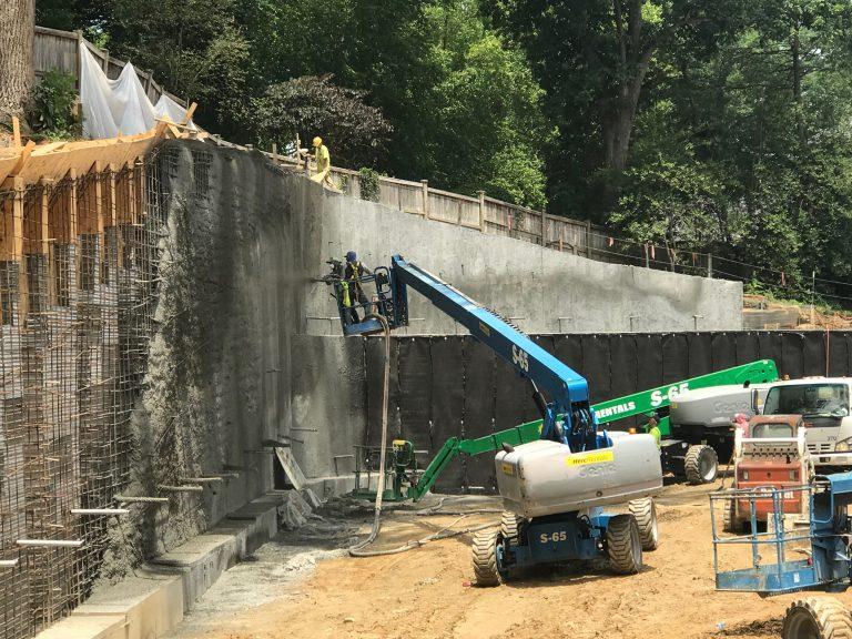 Shotcrete application on a commercial soil nail wall